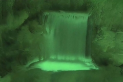 Time Ghosted Organically Blurred Garden Waterfall with Green Tint Loop
